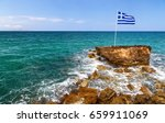 greek flag  sea and shore in... | Shutterstock . vector #659911069