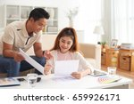 portrait of young asian family... | Shutterstock . vector #659926171