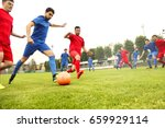 playing football | Shutterstock . vector #659929114