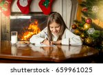 cute girl writing letter to... | Shutterstock . vector #659961025