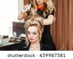 professional hairdresser using... | Shutterstock . vector #659987581