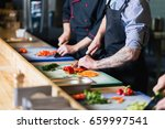 knife cutting pickled cucumber. ... | Shutterstock . vector #659997541