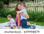 happy mother and two children... | Shutterstock . vector #659998879