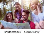 group of friends looking map...   Shutterstock . vector #660006349