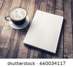 blank closed book and coffee... | Shutterstock . vector #660034117