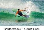 Man Practicing Kitesurfing On...