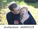 father comforts crying son child | Shutterstock . vector #660055129