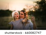 mother and daughter enjoy... | Shutterstock . vector #660082747