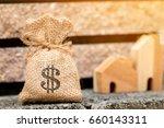 money bag put on the cement... | Shutterstock . vector #660143311