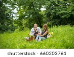 young family having picnic at... | Shutterstock . vector #660203761