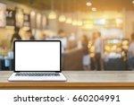 open laptop computer  lying on... | Shutterstock . vector #660204991