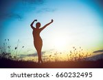 silhouette of woman praying... | Shutterstock . vector #660232495