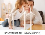 funny father blowing on... | Shutterstock . vector #660268444