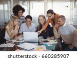 cheerful colleagues discussing... | Shutterstock . vector #660285907