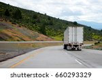 a big rig semi truck with a dry ... | Shutterstock . vector #660293329