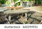 fallen flowers on old wooden... | Shutterstock . vector #660294931