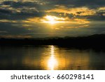 sunset at the river | Shutterstock . vector #660298141
