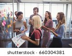 cheerful business people making ... | Shutterstock . vector #660304381