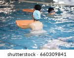 child holding a floating board... | Shutterstock . vector #660309841