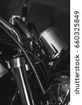 Small photo of Closeup of chopper's chrome handlebar, fork, and actuator. Black and white