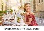 woman having italian coffee at... | Shutterstock . vector #660331081