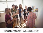 team applauding while... | Shutterstock . vector #660338719