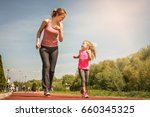 caucasian mother and daughter... | Shutterstock . vector #660345325