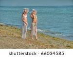 Two Women In Bikinis Standing...