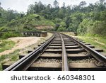 rail tracks on a stone bridge... | Shutterstock . vector #660348301