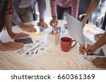 Small photo of Business people working together on creative office desk
