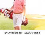 midsection of man with golf... | Shutterstock . vector #660394555