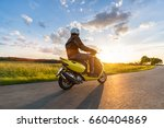 motor biker riding on empty... | Shutterstock . vector #660404869