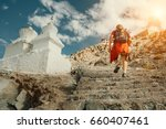 tourist man climbs up stairs to ... | Shutterstock . vector #660407461
