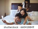 happy family taking a selfie on ... | Shutterstock . vector #660418849
