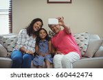 happy family taking a selfie on ... | Shutterstock . vector #660442474