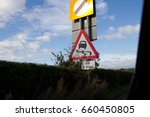 Small photo of Road Sign Swerve
