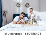 happy couple in love having... | Shutterstock . vector #660456475