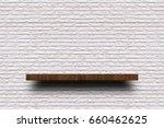 empty wooden shelf on old white ... | Shutterstock . vector #660462625