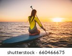 young woman on stand up paddle... | Shutterstock . vector #660466675