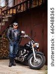 the biker stands near the... | Shutterstock . vector #660488365