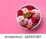 Small photo of Bowl of pink strawberry ice cream and fresh berries isolated on pink background. Top view
