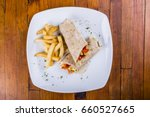 chicken wrap and fries  flat... | Shutterstock . vector #660527665