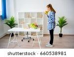 pregnant woman eating fruit | Shutterstock . vector #660538981