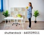 pregnant woman eating fruit | Shutterstock . vector #660539011