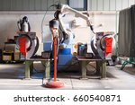 the mechanical arm performs... | Shutterstock . vector #660540871
