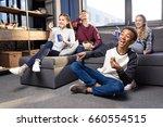 happy group of teenagers... | Shutterstock . vector #660554515