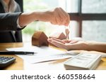 real estate agent holding house ... | Shutterstock . vector #660558664
