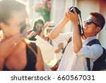chinese tourist is... | Shutterstock . vector #660567031