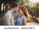 cheerful young couple embracing ... | Shutterstock . vector #660615871