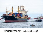 Small photo of Labuan,Malaysia-July 15,2016:A tugboat maneuvers vessel by pushing or towing the container ship with full of cargo in Labuan,Malaysia.The abolishment of cabotage policy is set to benefit the island